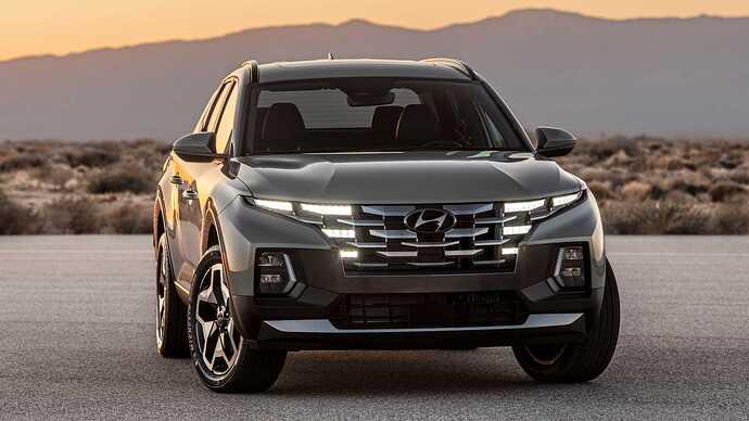 2022-hyundai-santa-cruz-front-lights-on-desert