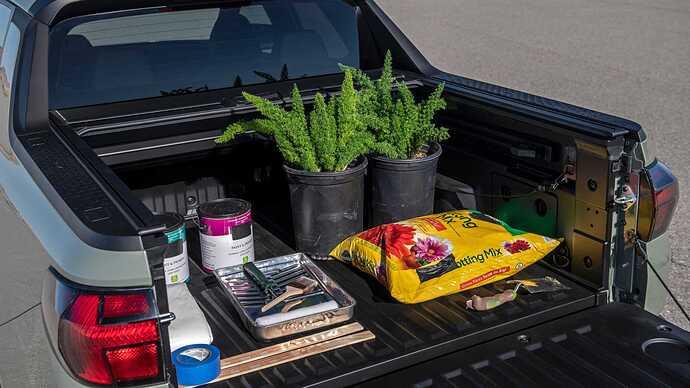 2022-hyundai-santa-cruz-bed-load-with-gardening-gear